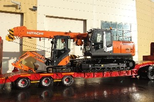HITACHI ZX210LC TELESCOPIC CRAWLER CRANE AND HITACHI ZX17 BEING DELIVERED TO THE UK